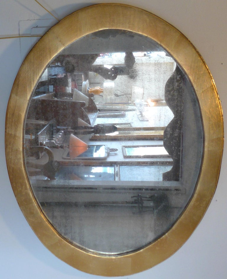 French 19th century oval gold hand painted oval wood framed mirror with original glass.