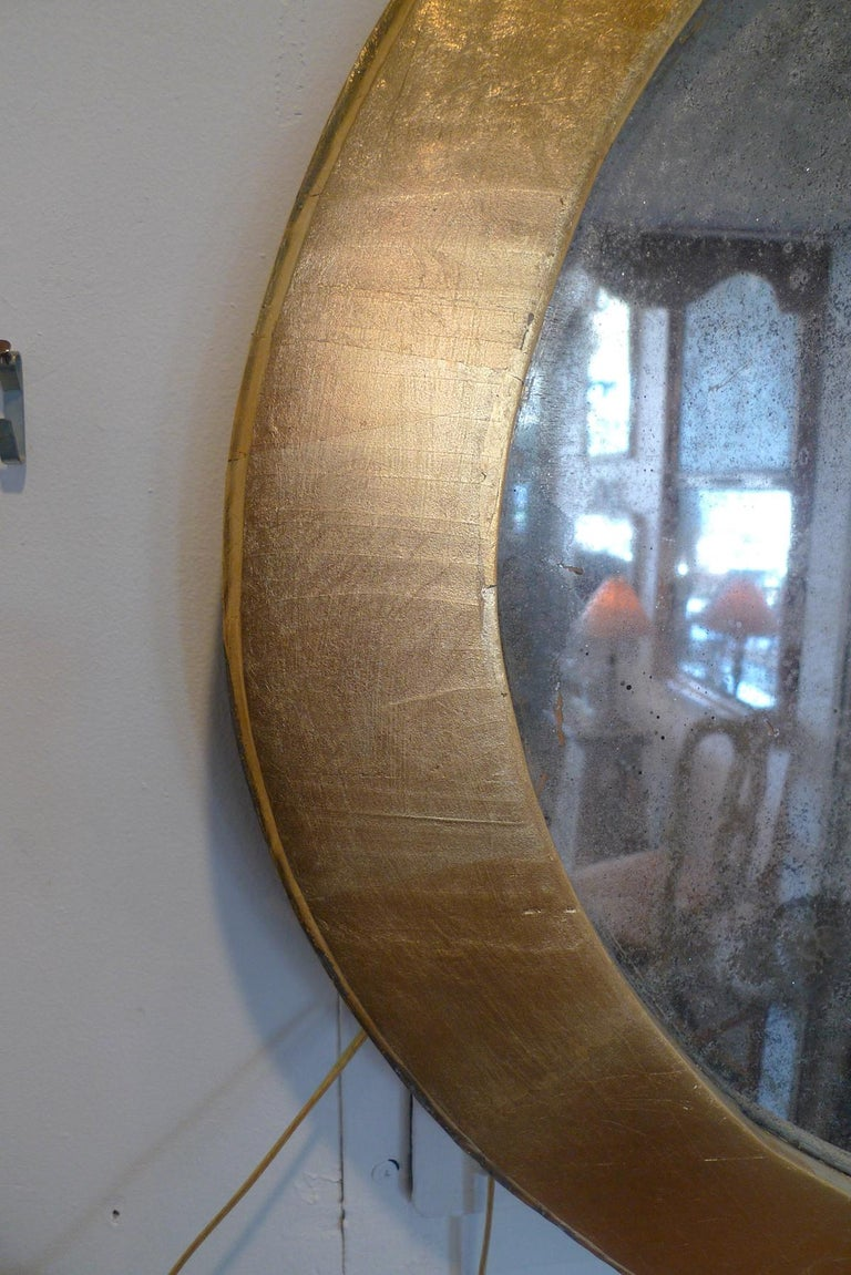 Hand-Painted French 19th Century Oval Gold Painted Oval Wood Framed Mirror and Original Glass For Sale