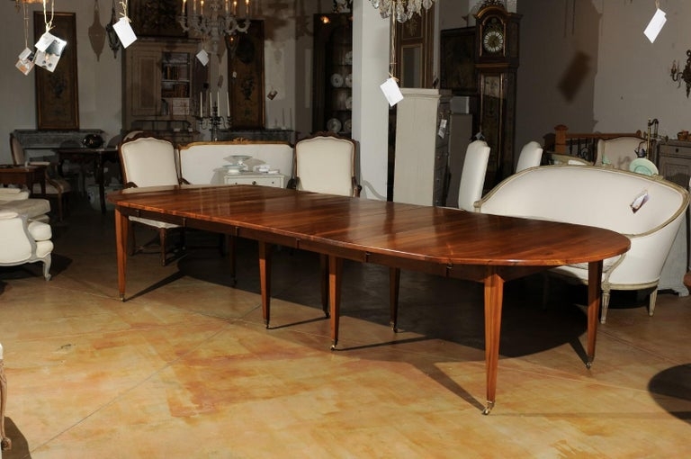 French 19th Century Oval Walnut Extension Dining Room Table with Brass  Casters