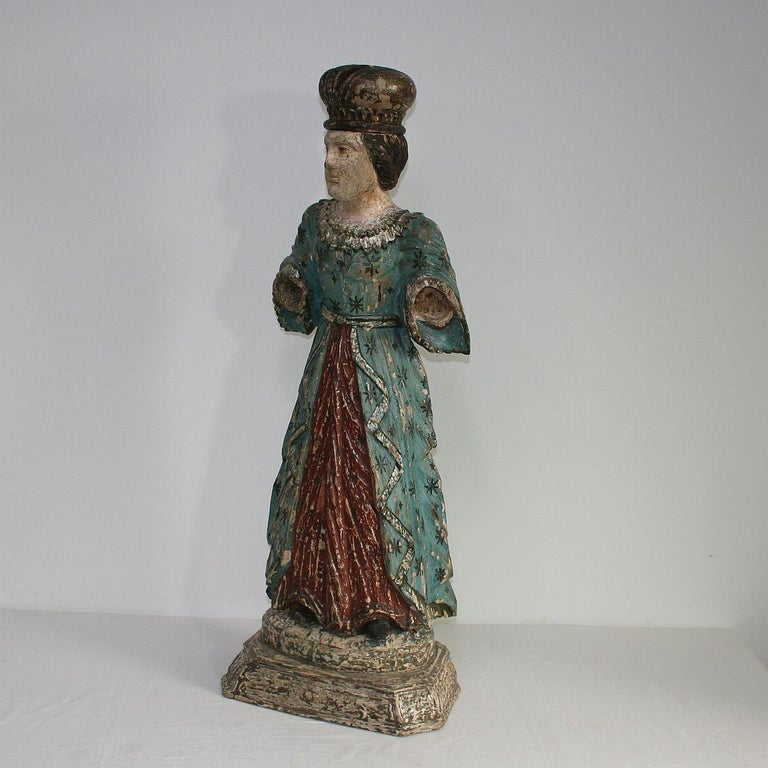 Stunning wooden Madonna or Santos. Beautiful old color and great expression, France, 19th century. Weathered, losses and old repairs. More photos available on request.