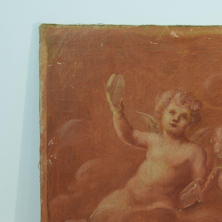 Beautiful and a bit primitive painting of 3-cherubs / angels in the clouds. France, circa 1850 Weathered and small losses.