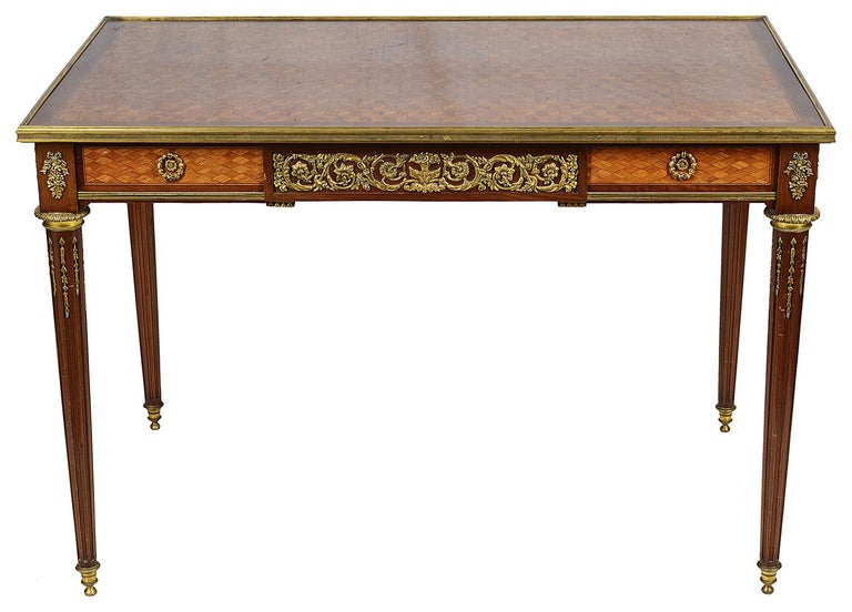A fine quality late 19th century French parquetry inlaid side table, having wonderful gilded ormolu mounts to the frieze depicting cornucopia either side of a classical female face, scrolling flower and foliate decoration, a single frieze drawer and
