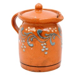 French 19th Century Pottery Pitcher with Orange and Blue Glaze and Foliage Motif