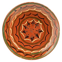 French 19th Century Pottery Plate with Rust Glaze, Black, Green and Cream Motifs