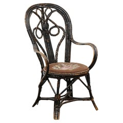 French 19th Century Rattan Child's Chair with Needlepoint Seat and Aged Patina