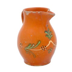 French 19th Century Redware Floral Pitcher with Orange, Cream and Green Glaze