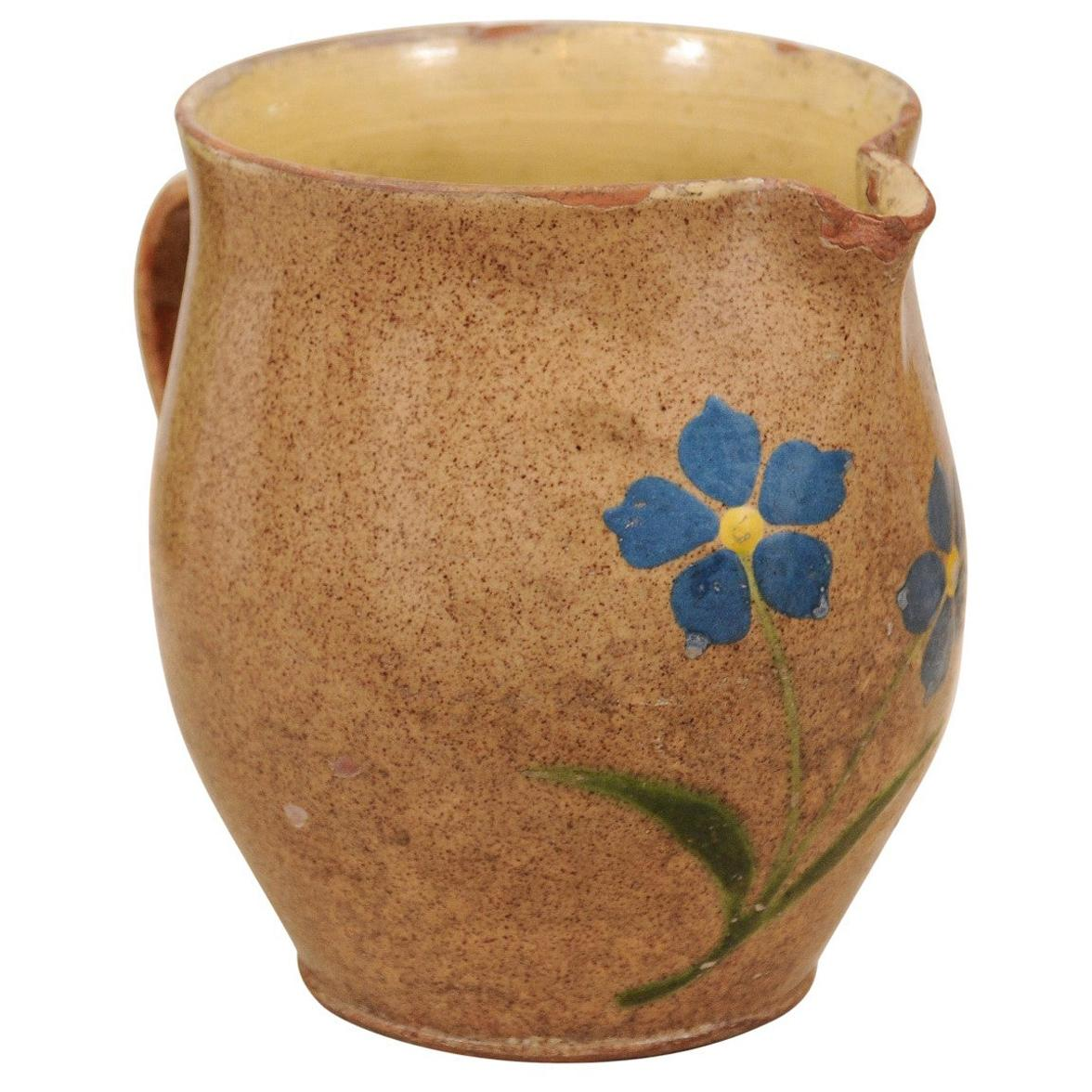 French 19th Century Rustic Pottery Pitcher with Mustard Glaze and Blue Flowers