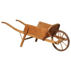 French 19th Century Rustic Wooden Child's Wheelbarrow with Curving Handles