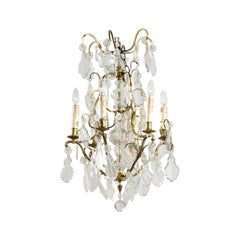 French 19th Century Six-Light Bronze and Crystal Chandelier with Scrolling Arms