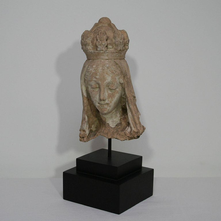 Beautiful and unique find. A terracotta head of a Madonna. France, circa 1850. Weathered. Measurement includes the base.