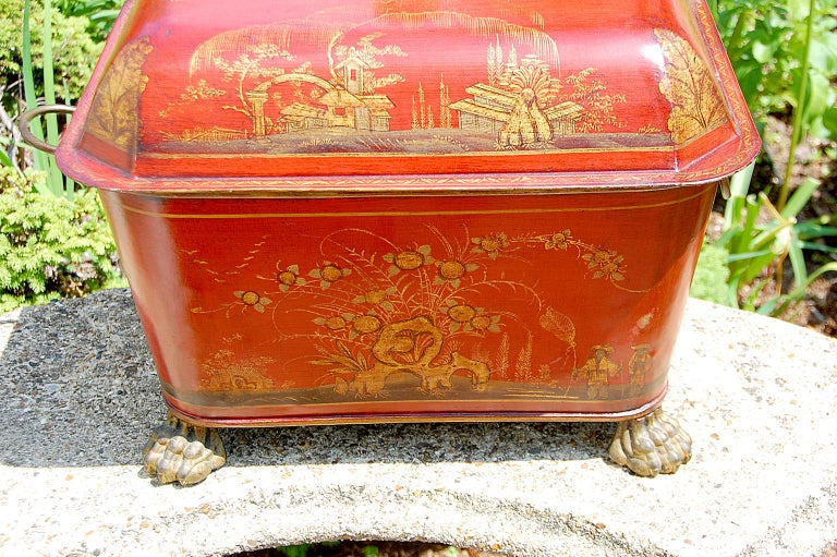 French 19th century chinoiserie decorated tole lidded coal bin on cast iron and gilded paw feet and cast and gilded loop side handles. The decoration and interior black paint is probably 20th century.