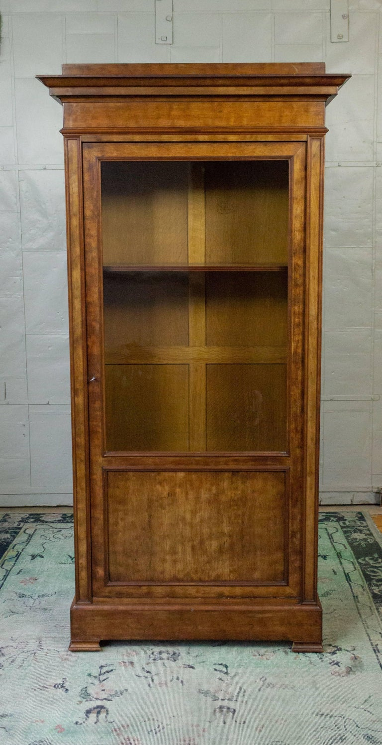 19th century French, walnut bookcase with original locking glass door. The inside depth of the piece is 12.5 inches and has two shelves. Additional shelves can be reproduced if needed. Overall, this piece is in very good condition with no finish