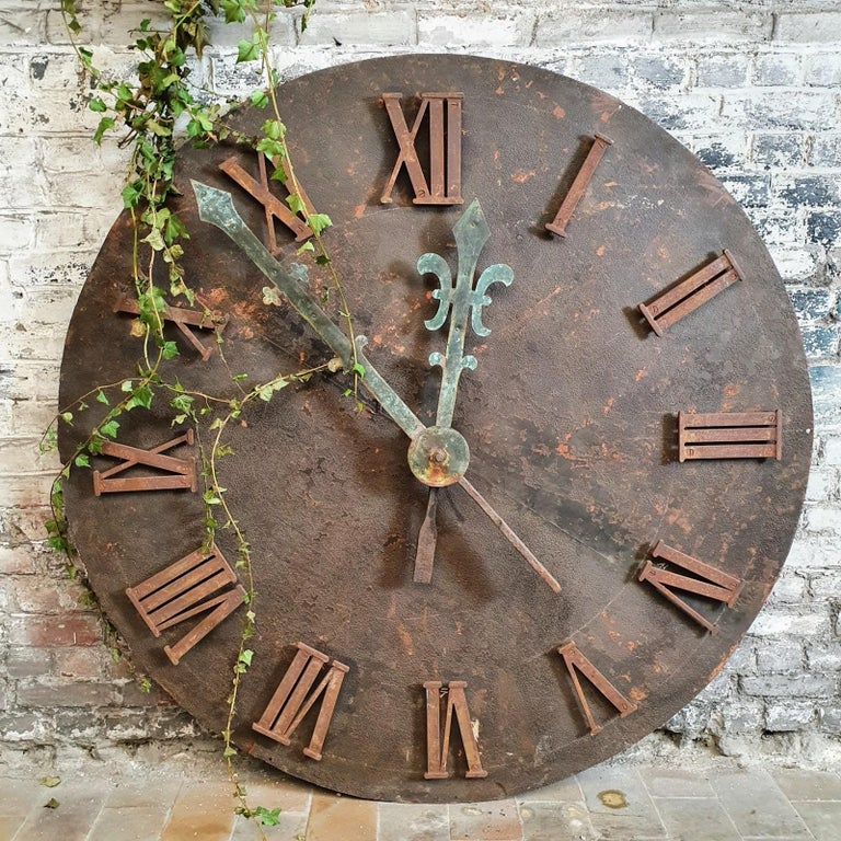 A very large, beautifully weathered French clock face from a church, French, 19th century