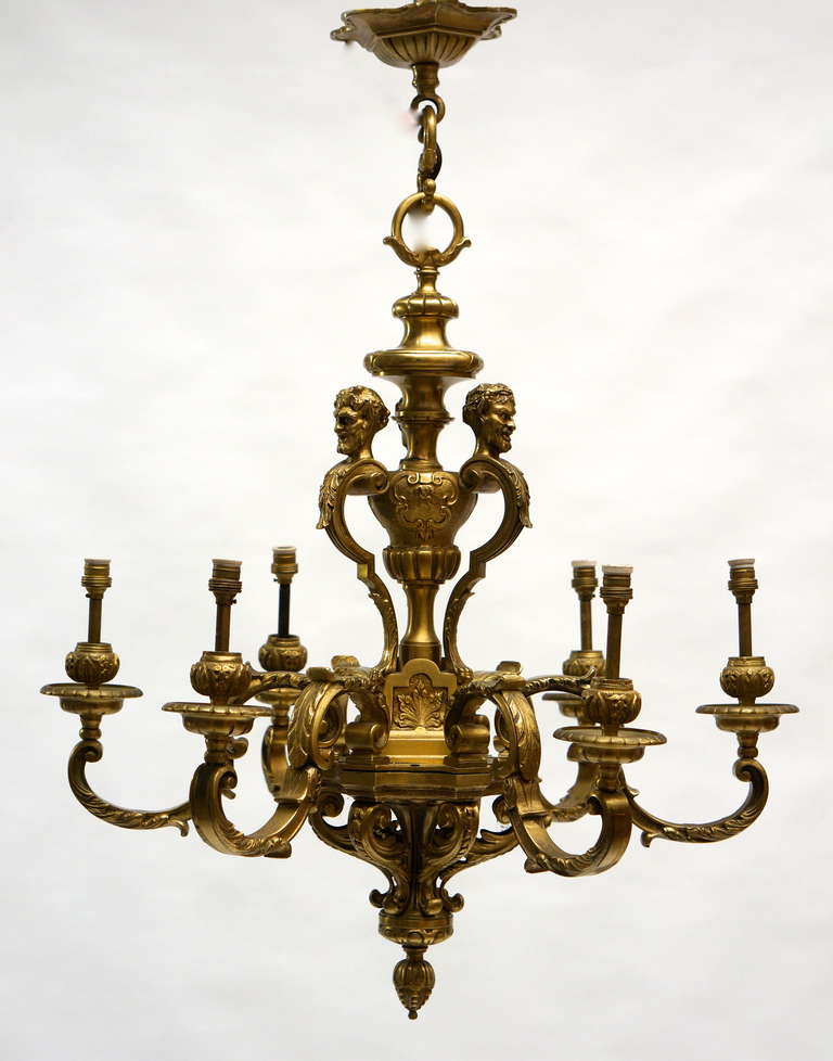 A quality French gilded bronze six-light Mazarin antique chandelier, having the original ceiling rose with super original gilded patination. Excellent quality and very well cast. Measures: Diameter 60 cm. Height fixture 68 cm. Total height 80 cm.