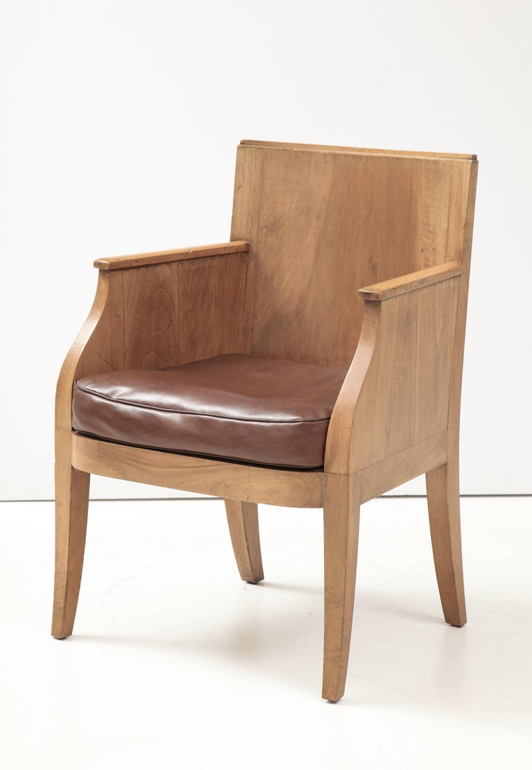 French 40's oak chair with original brown leather seat, France, c. 1940 Measures: 33.5 D: 24 W: 25 in.