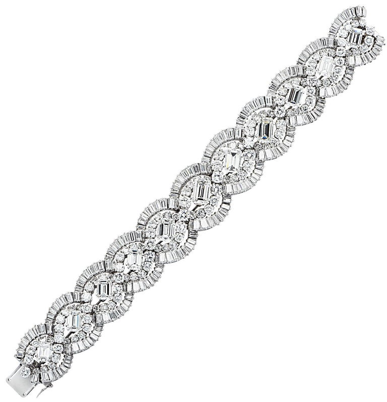 Sensational French diamond bracelet circa 1960, crafted in platinum, showcasing 58.66 carats of round brilliant cut, baguette cut and emerald cut diamonds weighing approximately 58.66 carats total, G-J color, VVS1-SI1 carats. Round brilliant cut and