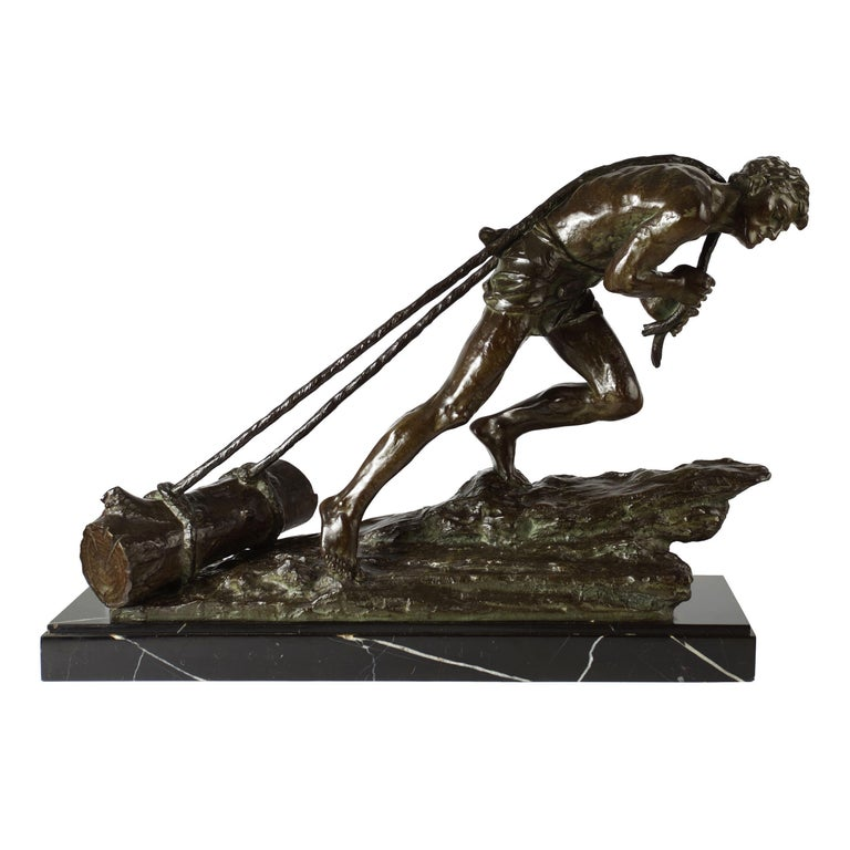 An incredibly powerful model from Edouard Drouot's collection of labor studies, it captures a lone figure dragging logs through the mire with two ropes stretched taught over his back. Only a slight garment protects him from the elements as he