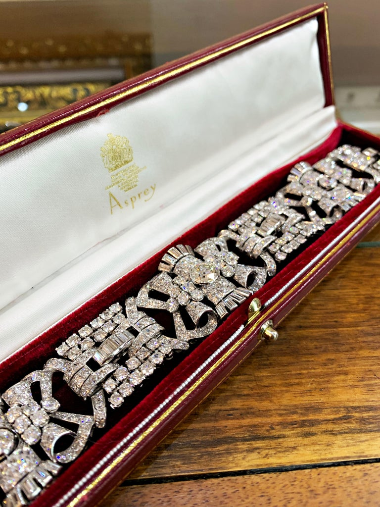 An exceptional handmade 1920's Art Deco bracelet set with a grand total of 573 diamonds totalling to an impressive approximate weight of 42.00ct. This beautiful piece features 3 larger rubover set old cut diamonds on 3 links, with the centre stone
