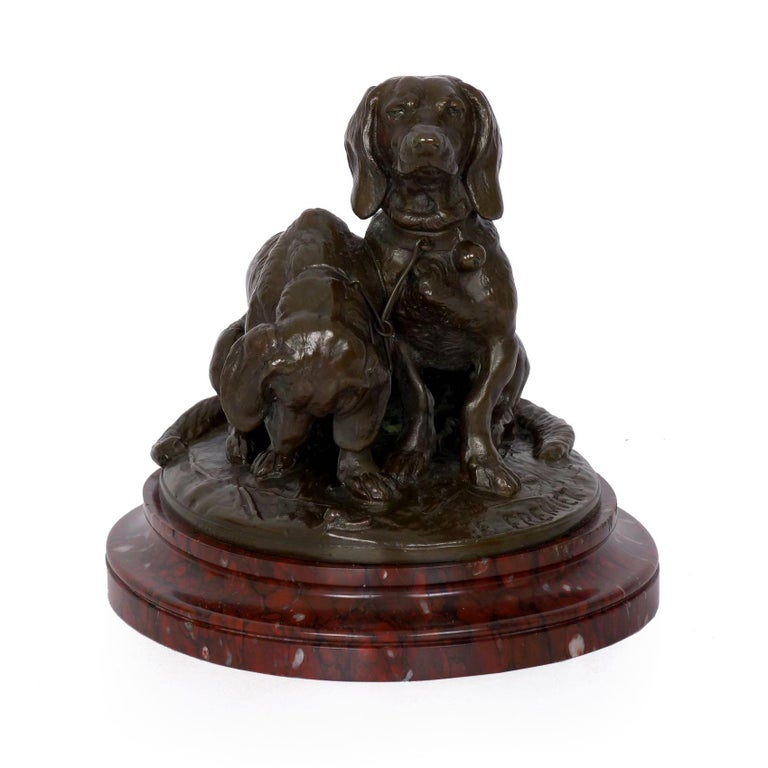 This is a simply gorgeous group sculpted in bronze, the title of which varies somewhat depending on the text you examine - depending on the reference text, it can be noted as Pair of Seated Dachshunds, Chiens Bassets and Deux Bassets. Though