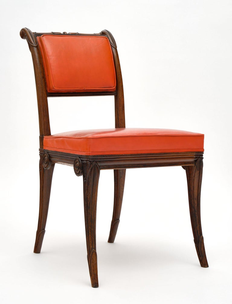 Set of five Charles X style antique dining chairs made of solid, hand carved rosewood. These French chairs feature the original red-orange upholstery.