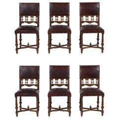 French Patina Leather Dining Chairs