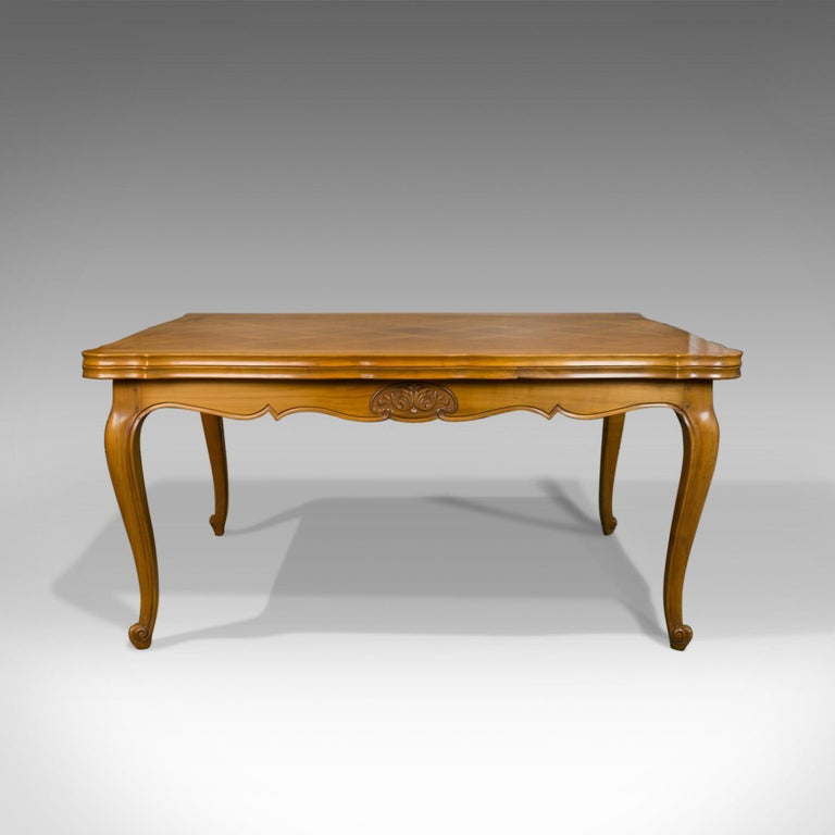 This is a French antique draw leaf dining table. A beech, extending table in the Louis XV-revival taste, seating up to 10 and dating to the early 20th century, circa 1930.  Delightful antique French farmhouse table Seating six closed or up to ten