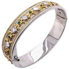 French Antique Emerald Diamond Bangle in 18 Karat Yellow White Gold, circa 1970