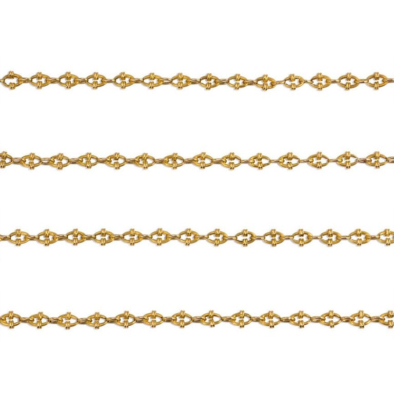 An antique long guard chain of small reeded links, in 18k gold.  France  Approximately 51