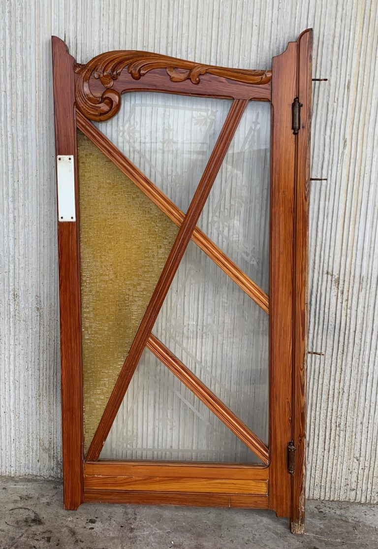 So many uses for this stained and beveled glass tiger cut oak pub or salon door. Entrance to your home bar, pantry or just a divide from one section of your home to another. The side wood pieces are the jamb for the door. It is meant to hang in a