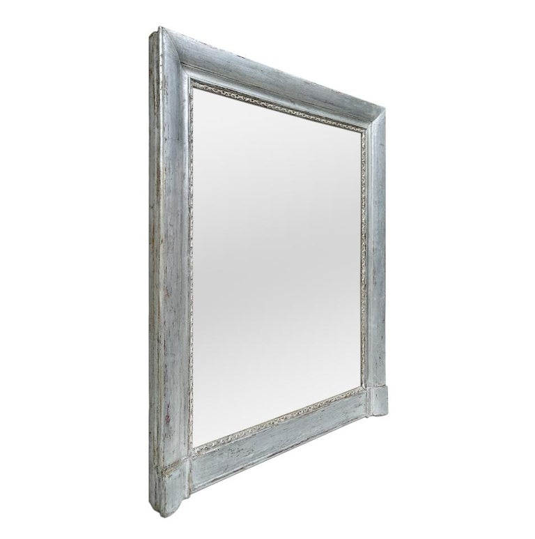 Antique mantel mirror, Louis-Philippe French style, circa 1890. Antique silvered wood mirror frame with stylised decor at the edge the glass. Re-gilding to the leaf patinated. Antique frame width 9.5 cm / 3.74 in. Modern glass mirror. Antique wood