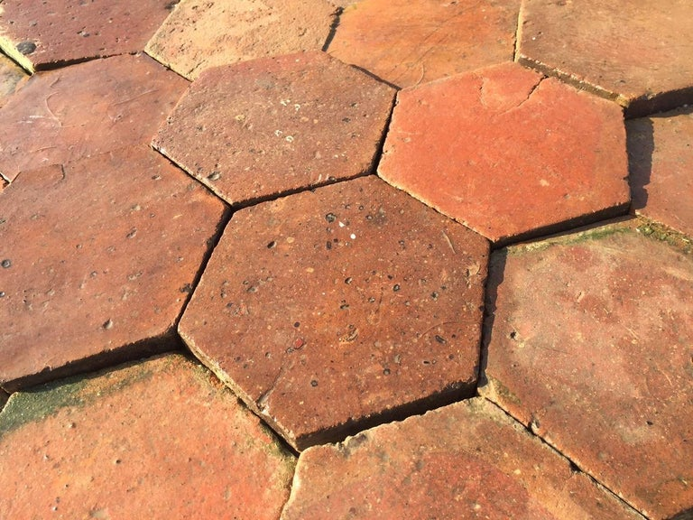 Rare and unique French antique hexagonal terracotta floors tiles (tomettes anciennes), handcrafted flooring in the 18th century from France. Great quality and original patina from that period, beautiful design. Rare and unique, excellent quality.