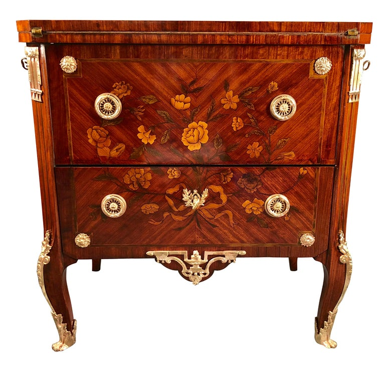 The French antique transformation furniture chest of drawers, originates from Paris and dates back to 1800. The special feature of this unique and extraordinary piece is hidden underneath its top. The top can be lifted up and reveals the top of a