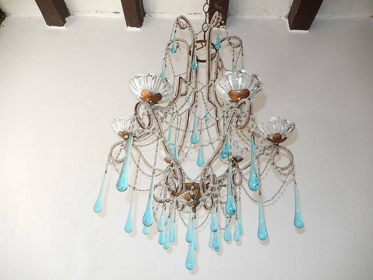 Housing six lights, sitting in crystal bobèches. Rewired and ready to hang, double beaded throughout with different sizes of aqua blue Murano drops. Adding another 12 inches of original chain and canopy. Free priority UPS shipping from Italy, no