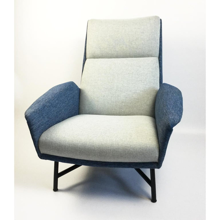 1950s armchair designed by Claude Vassal and edited by Claude Delors Black metal structure and re-upholstered with heather blue and white fabric.