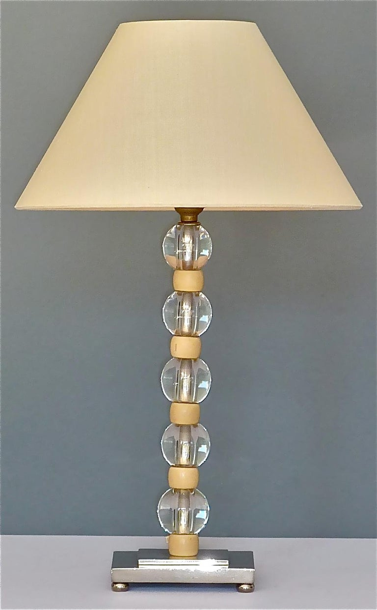 Beautiful French modernist Art Deco table lamp which has been designed and executed in the 1920s-1930s in France and which is attributed to or very much in the style of the wonderful designs by Jacques Adnet in cooperation with Baccarat or Maison