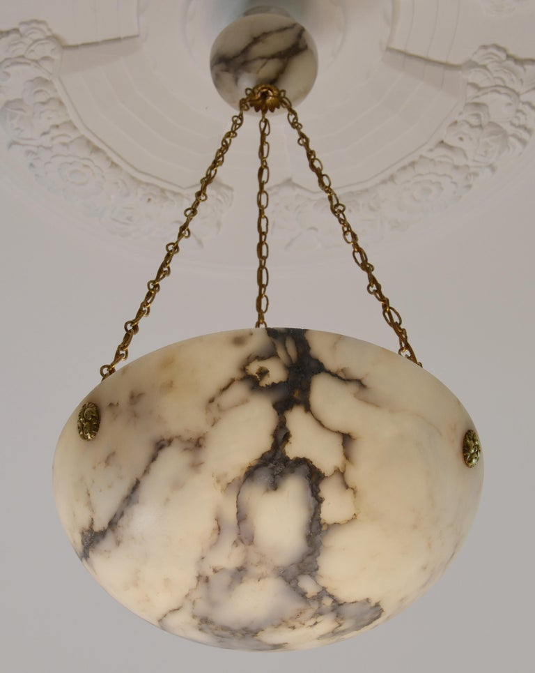 Any fair offer will be examined with the utmost attention, please send a message. French Art Deco pendant chandelier, France, 1920s. Alabaster and brass. Thick alabaster shade hung on its original fixture. Canopy made of alabaster. Brass