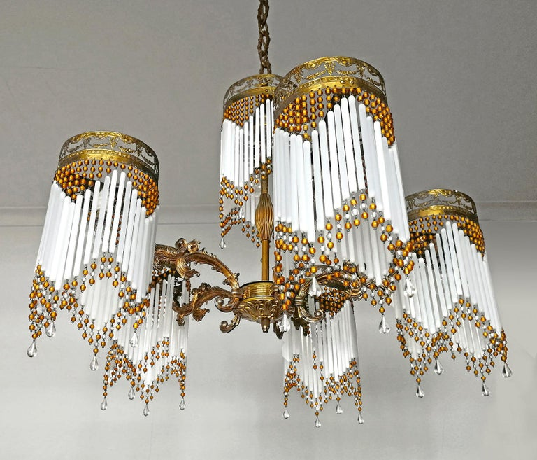Gorgeous antique French chandelier in beaded opaline glass tubes, Art Deco / Art Nouveau, circa 1920. Measures: Height 45.28 in. (chain 17.71 in.)/ (115 cm (chain 45cm)) Diameter 27.56 in. (70 cm) 7-light bulbs E14/ good working
