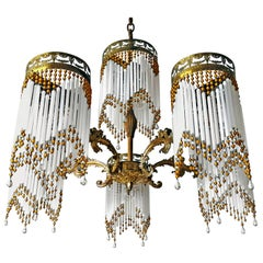 French Art Deco and Art Nouveau Amber Beaded Fringe and Gilt Ornate Chandelier
