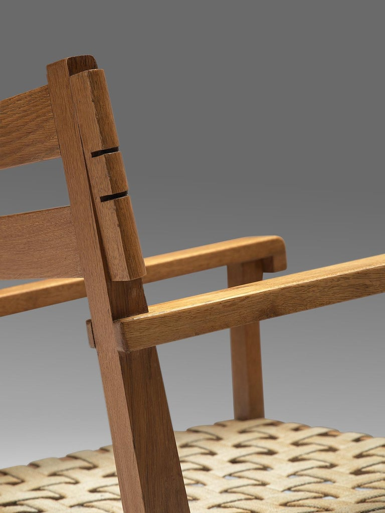 Mid-20th Century French Art Deco Armchair in Solid Oak with Woven Seat For Sale