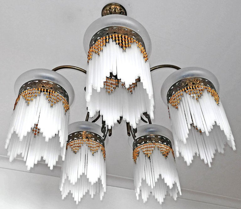 Gorgeous antique French chandelier in beaded glass tubes, Art Deco / Art Nouveau. Measures: Diameter 23.63 in / 60 cm Height 27.56 in / 70 cm 5-light bulbs E14/ good working condition Assembly required. Bulbs not included.