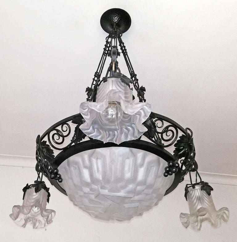 Beautiful original French signed 1930 Art Deco chandelier or pendant, signed Degue. The hand forged wrought iron frame features intricately hand forged grape and leaf accents.  Measures: Width 30 in / 76 cm Height 35.5 in / 90 cm Weight 18 lb.