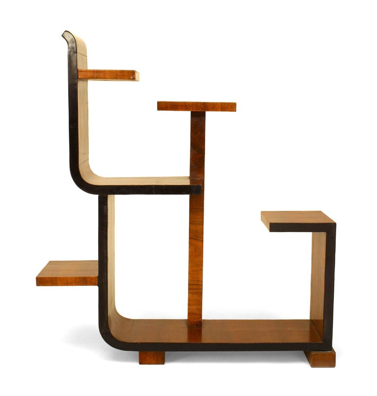 Small French Art Deco étagère or tier table composed of walnut  in an asymmetrical, labyrinthian arrangement of straight shelves and and curved sides.