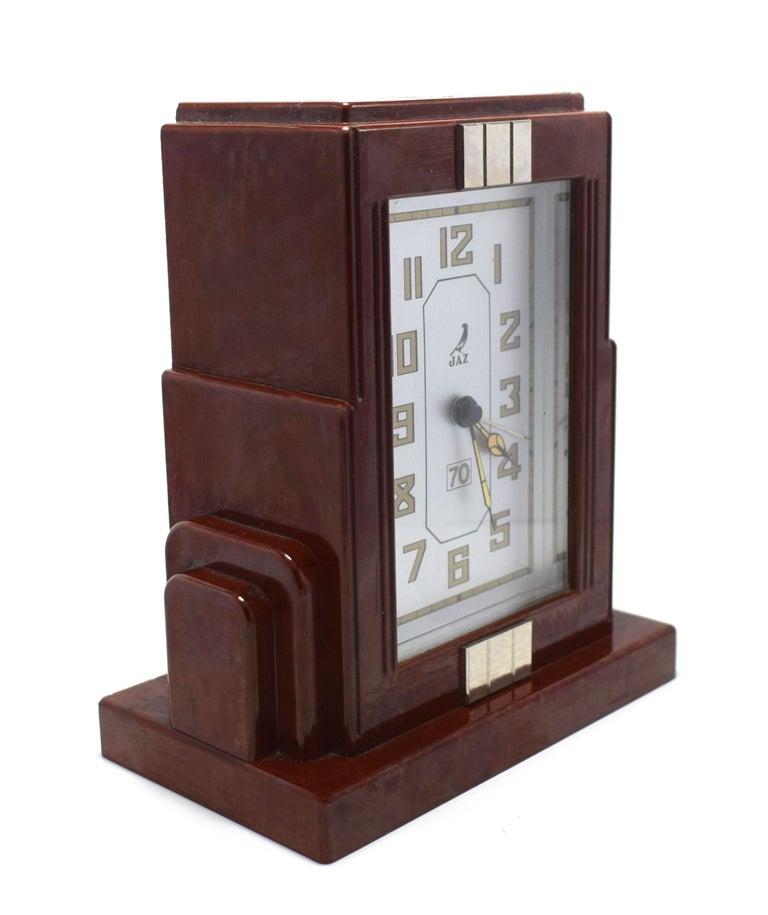 Fabulous Art Deco clock by JAZ a French clock maker. This clock is in a deep cherry red with black speckles and wonderful skyscraper shaped casing. The condition of the face is particularly good showing little to no signs of it's true age. The