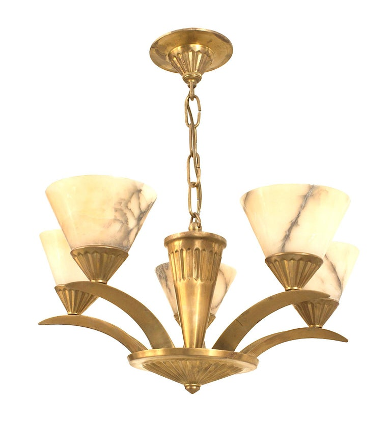 French Art Deco brass (circa 1925) chandelier with 5 flaired arms emanating from a cone form center and supporting conical shaped alabaster shades.
