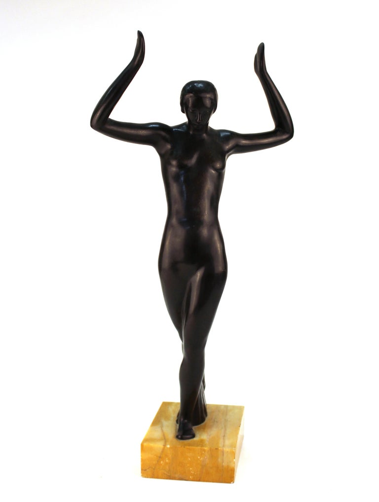 French Art Deco period sculpture of a female dancer cast in bronze, atop a marble base. The base of the bronze sculpture has a makers mark. The piece is in good vintage condition, with minimal age-related wear to the bottom of the marble base.