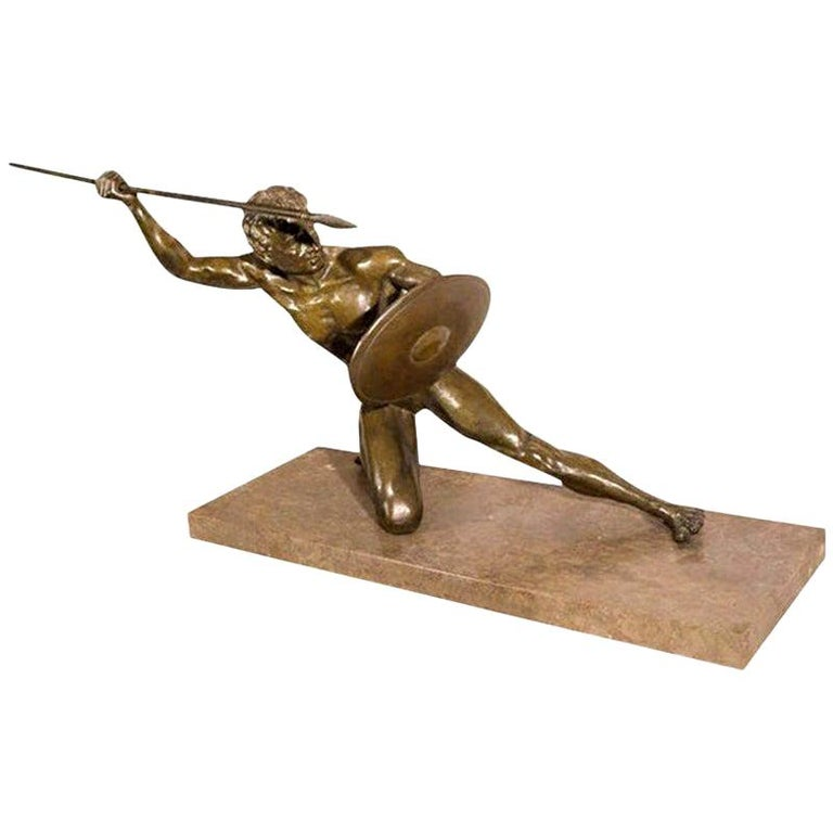 Finely cast French Art Deco bronze sculpture on marble base. This handsome French Art Deco bronze of an athlete is signed O. Cipriani on inside of shield. Our stunning deco bronze has the greatest patina!