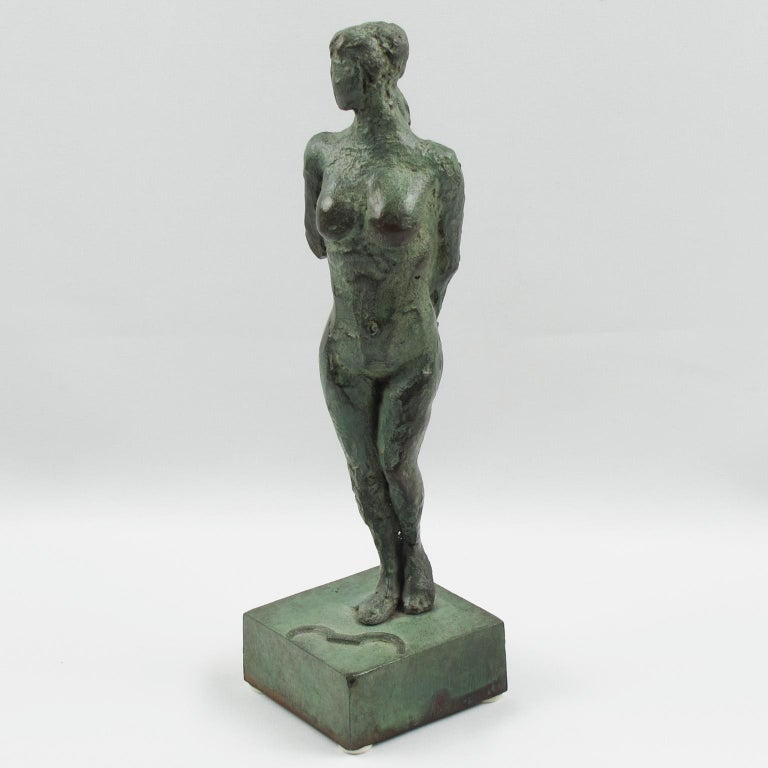 Stunning French Art Deco bronze sculpture figurine featuring a stylized free interpretation of Diana The Huntress 'Diane Chasseresse'. The nude female has a handmade feel textured pattern design with both arms behind her back. The bow is not in her