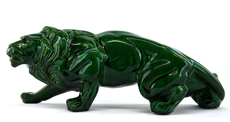 Green lion, France, 1930s. Ceramic. This lion has been made in black, green and red. This is the green one! Measures: Width 18.9