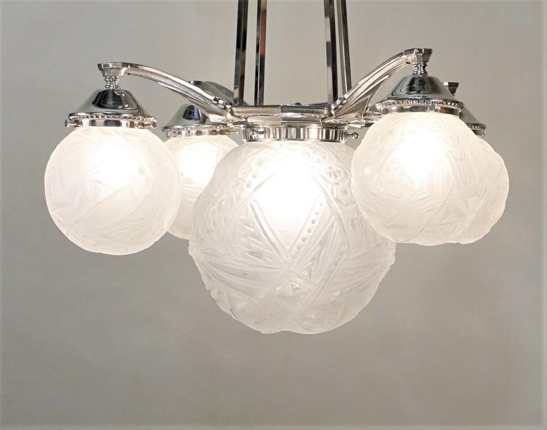 French five glob geometric clear Frost glass and polished nickel chandelier by Muller Freres.