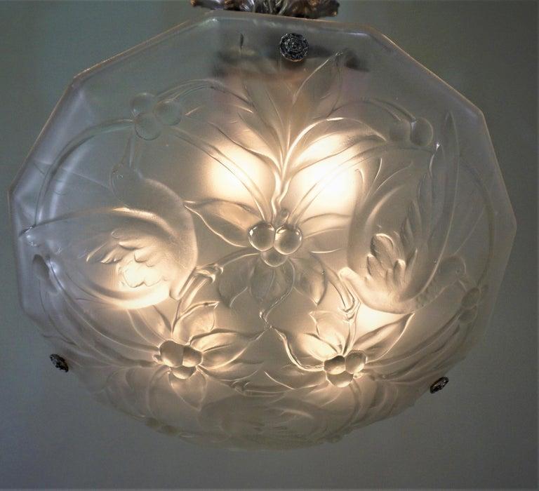 Clear frost glass with birds eating cherries art deco chandelier with nickel on bronze hardware. Six lights max 60 watt each.